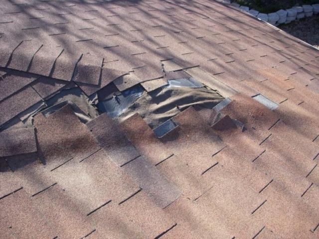 Damaged and missing asphalt roof shingles