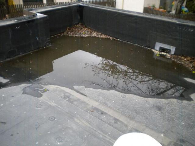 Ponding Water On Flat Roof After 1 Week Without
